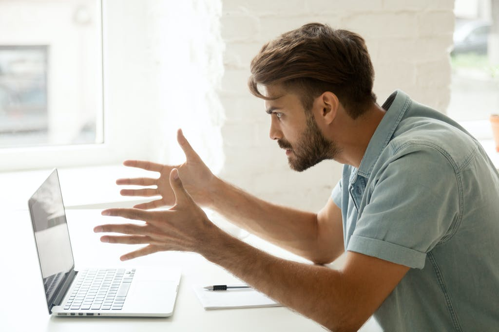 Man frustrated with bad internet connection