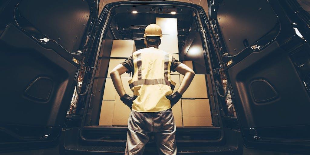 Man looking at van with packages