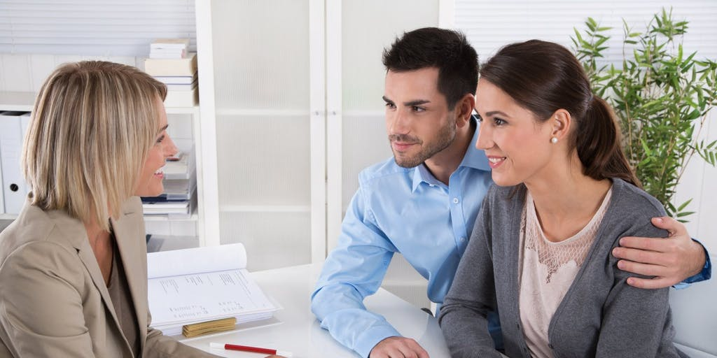 couple discussing mortgage with adviser
