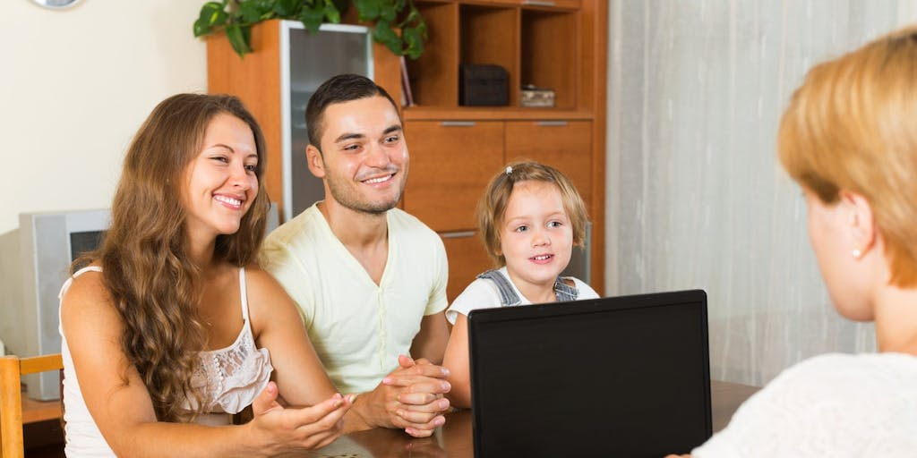 Young family discussing mortgage with adviser using laptop
