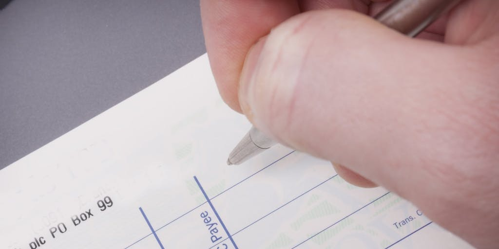 Hand writing a cheque