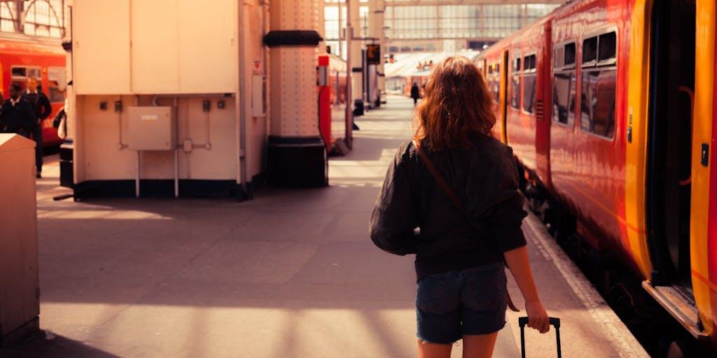 Woman boarding train in station
