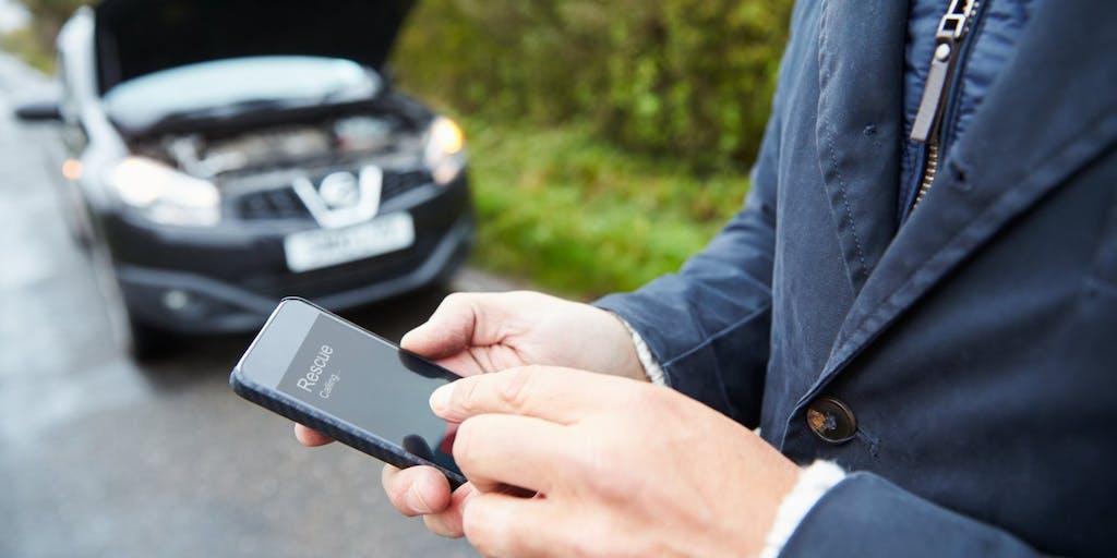 car-broken-down-man-on-phone