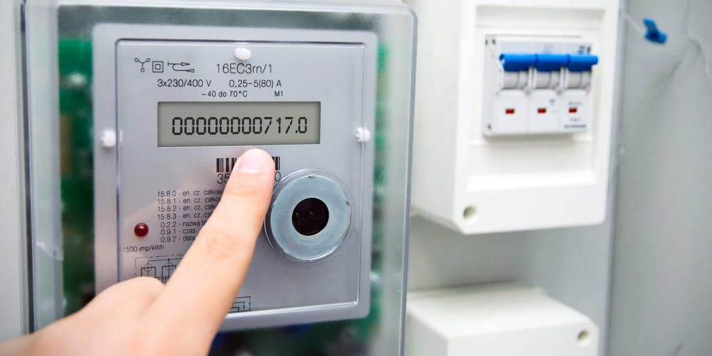 Attractive hand pointing at energy meter