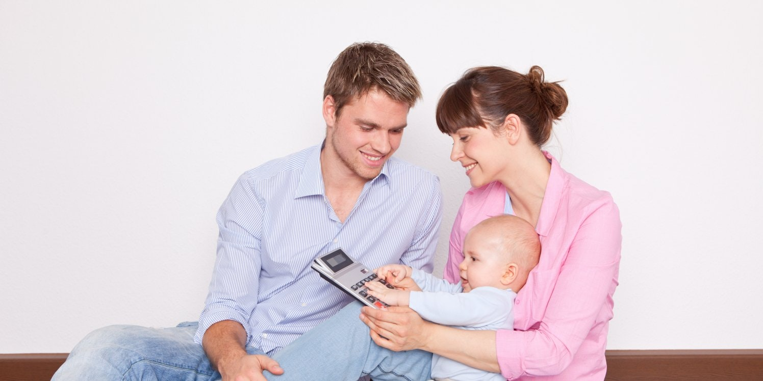Parents with baby holding calculator