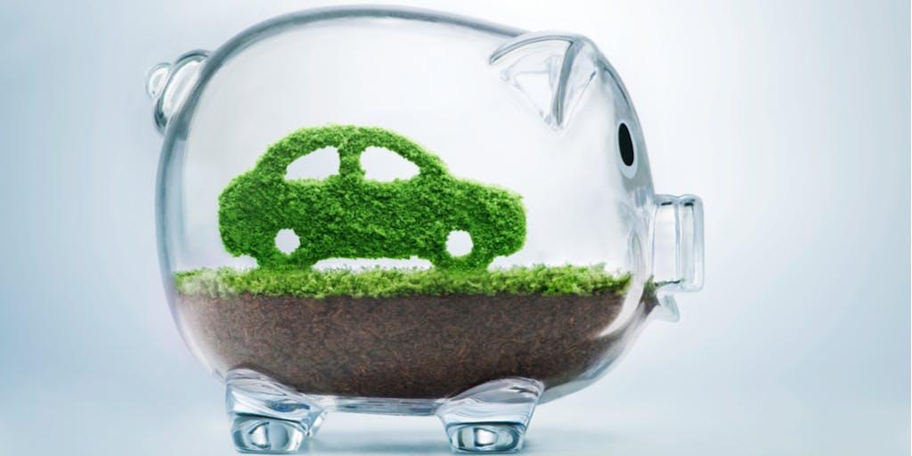 green car inside piggy bank