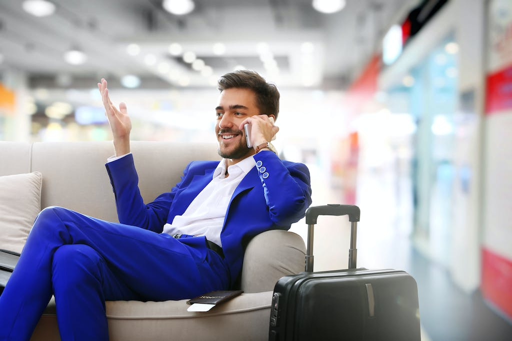 Man making international calls from airport