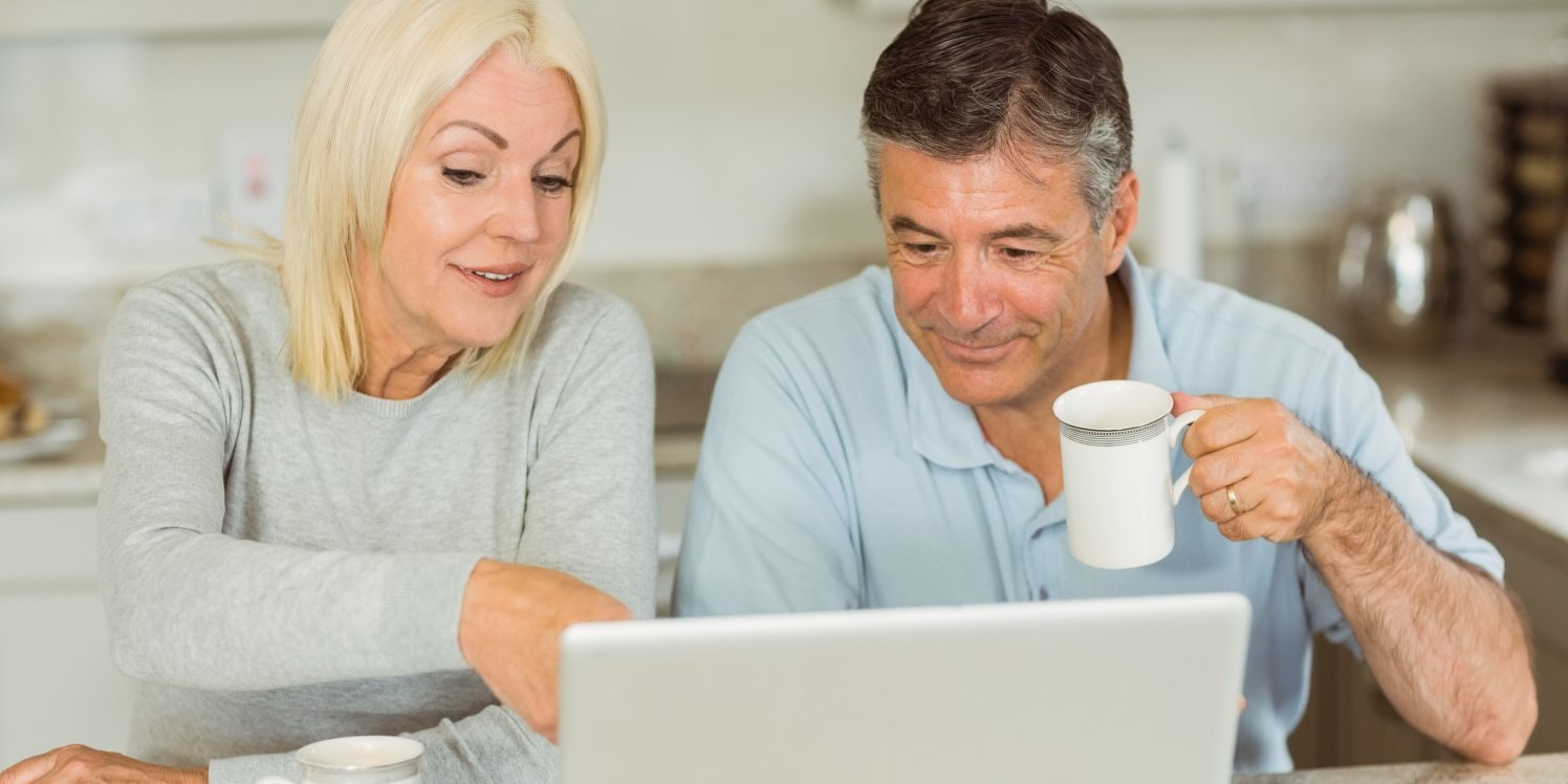 older-couple-looking-at-laptop