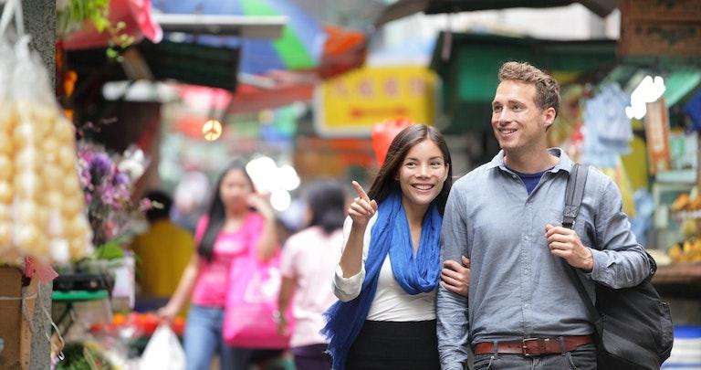 Happy couple shopping on holiday