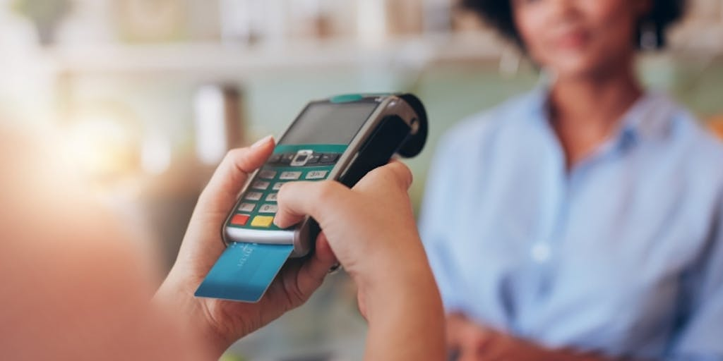 credit card in a portable credit card reader machine