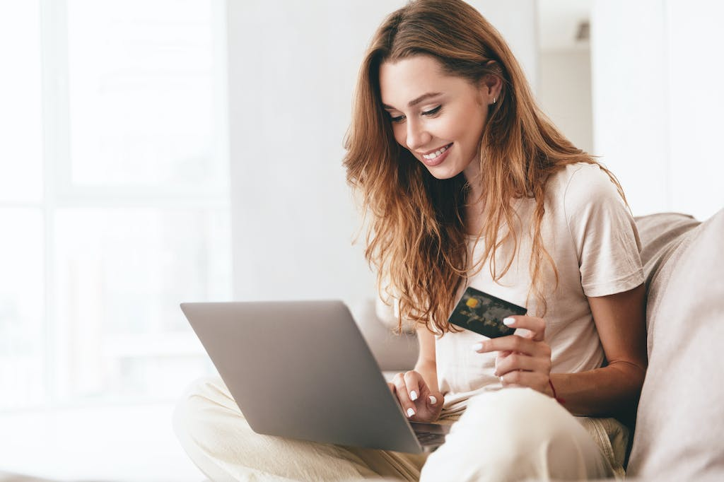 Woman switching energy supplier when in credit