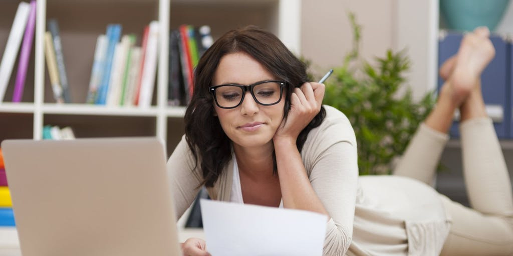 Woman reading energy bill