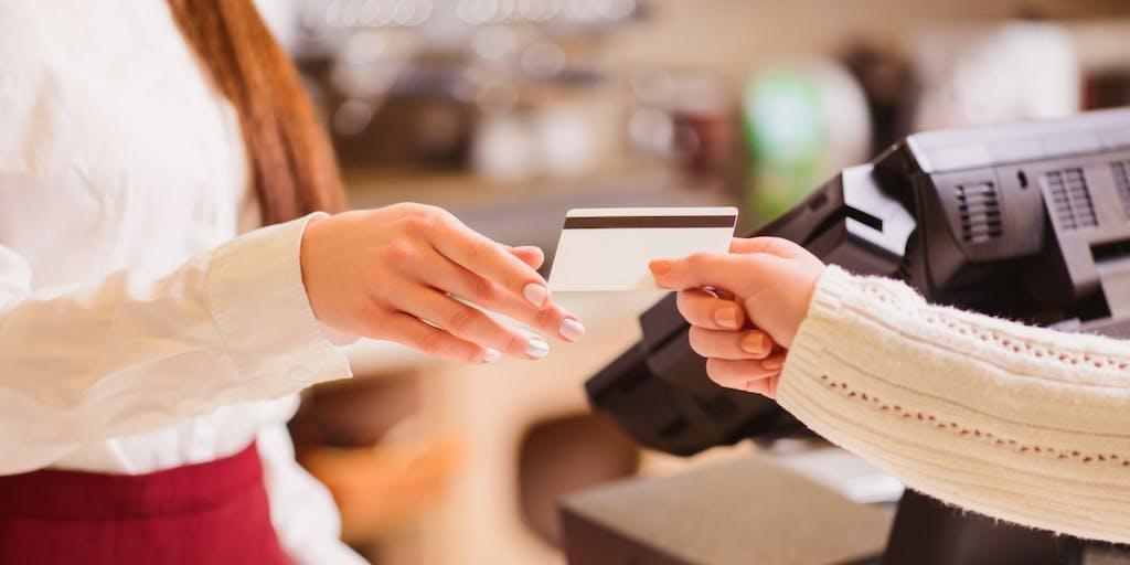 woman-handing-over-credit-card