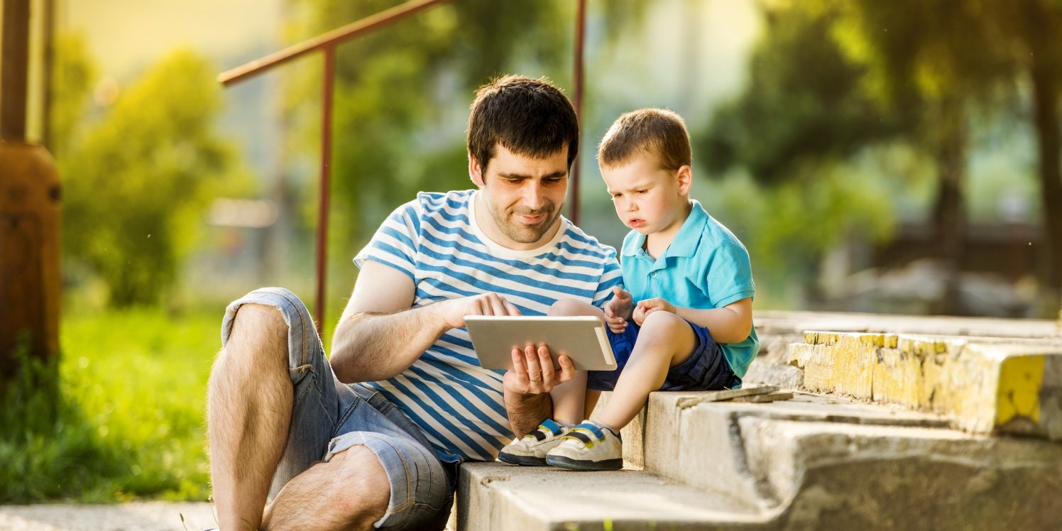 father-and-son-on-ipads
