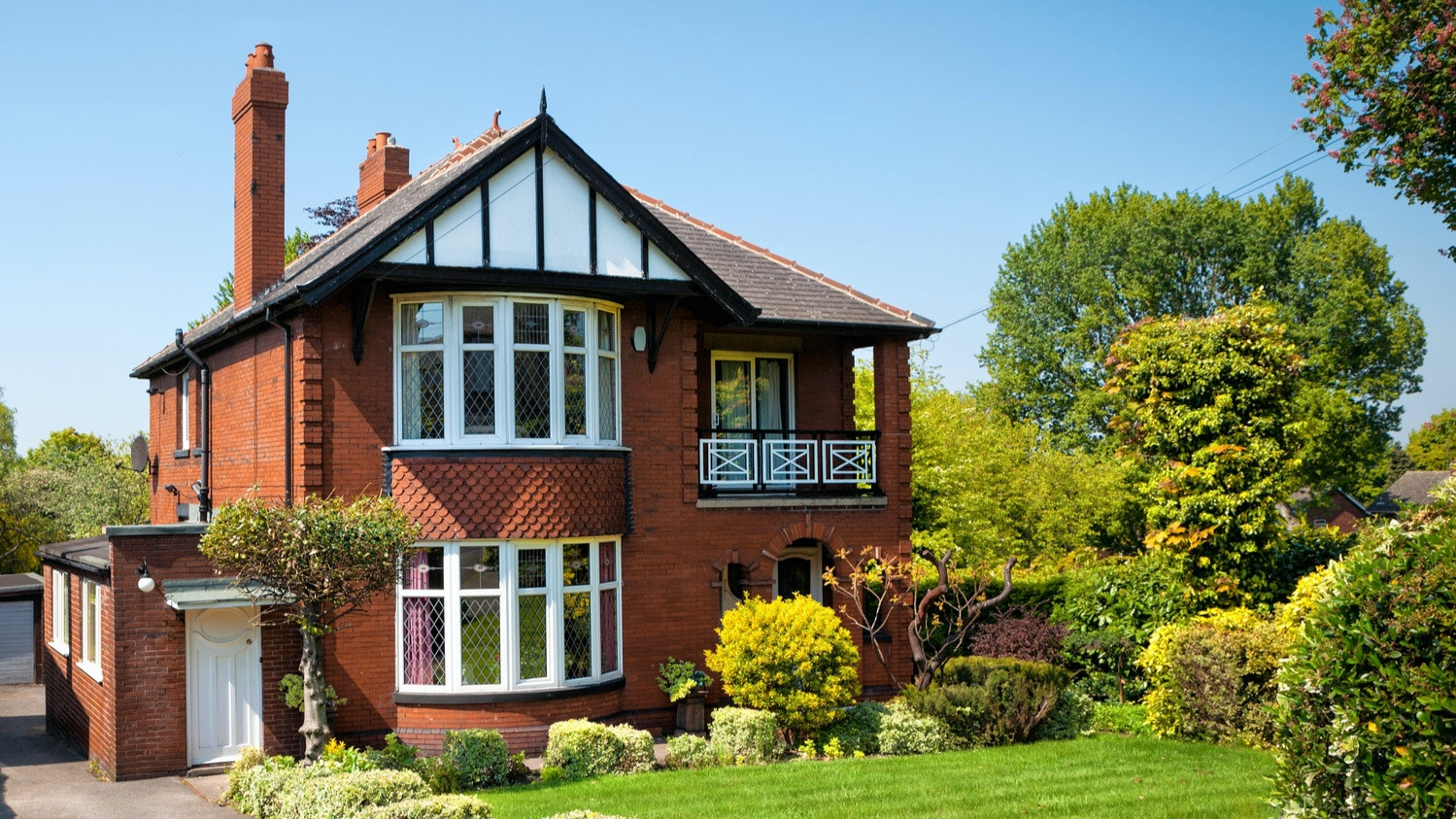 Large red brick house with garden