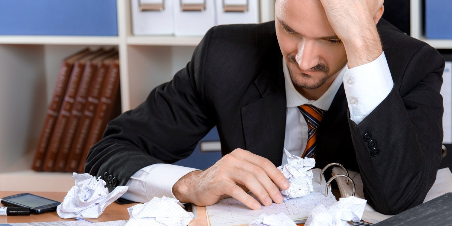 Man at desk looking stressed