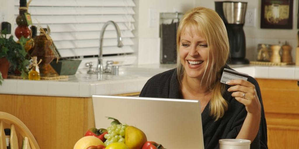 woman-on-laptop-with-credit-card