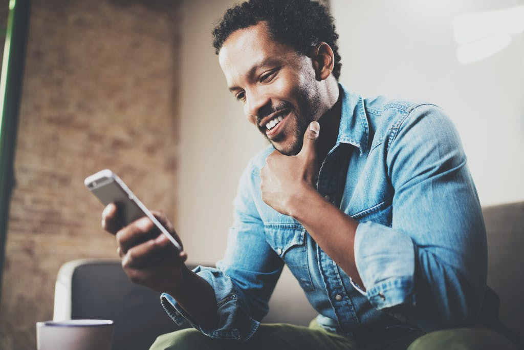 Man using data on mobile phone