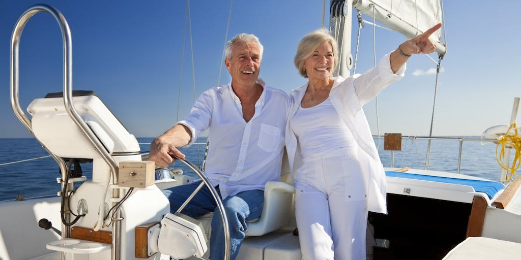 happy-senior-couple-at-the-wheel-of-boat