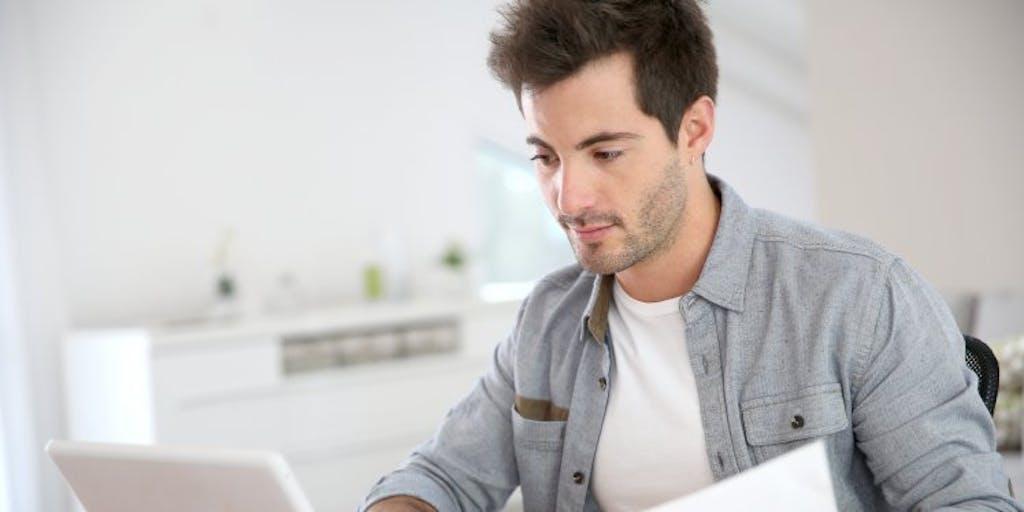man-using-laptop-at-home